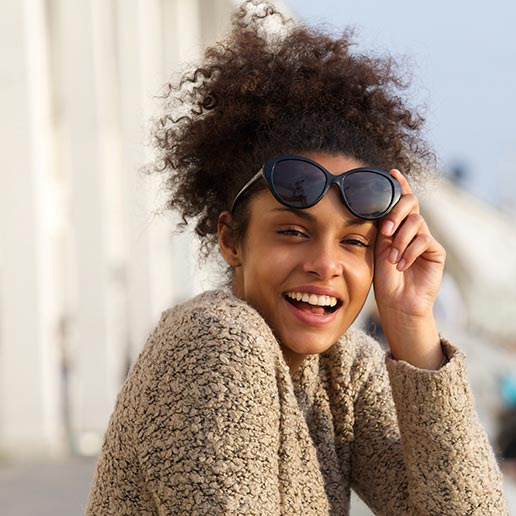 Smiling young woman with sunglasses